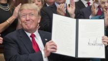 US President Donald J. Trump holds up an executive order on healthcare after signing it during a ceremony in the Roosevelt Room of the White House in Washington, DC, USA, Oct. 12, 2017. EPA-EFE/MICHAEL REYNOLDS