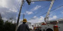 Employees of the state-owned utility AEE doing repairing works in San Juan, Puerto Rico on Oct. 6, 2017. EPA-EFE FILE/Thais Llorca