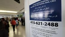 A sign in multiple languages informing travelers about the travel ban at San Francisco International Airport arrivals international terminal in San Francisco, California, USA, June 30, 2017. EPA-EFE FILE/JOHN G. MABANGLO
