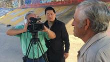 Undated photo showing Filmmaker Charlie Minn (C), interviewing Jesus Hernandez (R), father of Sergio Hernandez Güereca, a 15-year-old resident of Ciudad Juarez, Mexico just across the Rio Grande from El Paso, USA, who was fatally shot by US Border Patrol agent Jesus Mesa on June 7, 2010, in Ciudad Juarez, Mexico. EPA-EFE/Charlie Minn