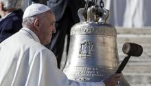 Pope Francis rings a bell that was donated to him during the general audience in S. Peter Square in Vatican City, Nov. 8, 2017. EPA-EFE/ANGELO CARCONI