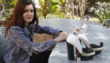 Mexican university student Ditza Aramburo poses with the high heel shoes she designed, which have pepper spray canisters in the heels, as a woman's self-defense item. EFE/FRANCISCO GUASCO