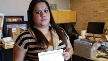 Venezuelan Deferred Action for Childhood Arrivals program (DACA) beneficiary Laura Rodriguez holds her eligibility renewal documentation, rejected by immigration authorities because it did not arrive in time due to errors with mail delivery, in Chicago, USA on Nov. 15, 2017. EPA-EFE/Enrique García Fuentes