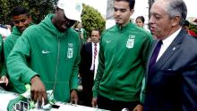 "Atletico Nacional players Rodin Quiñones (L) and Felipe Aguilar (C), accompanied by the club president Andres Botero (R), deposit a jersey of their team in a ""time capsule"" during a tribute to the victims of the Chapecoense soccer club who died in a plane crash a year ago in the municipality of La Union, Colombia, Nov. 28, 2017. EPA-EFE/LUIS EDUARDO NORIEGA A"