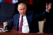Russian President Vladimir Putin speaks during his annual news conference to Russian federal, regional, and foreign media at the WTC Congress Center in Moscow, Russia, Dec. 14, 2017
