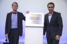 German historian of the University of Bielefeld Christopher Kopper (L) and the President of Volkswagen in Brazil Pablo Di Si (R) uncover a plaque in memory of the victims of the last Brazilian military dictatorship, during the presentation of a report on Volkswagen's role during the dictatorship, at the headquarters of the factory in the city of Sao Bernardo do Campo, Sao Paulo State, Brazil, Dec. 14, 2017.