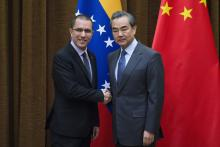 Venezuelan Foreign Minister Jorge Arreaza (L) shake hands with China's Foreign Minister Wang Yi (R) at the Ministry of Foreign Affairs in Beijing, China, Dec. 22, 2017.