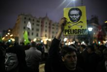 Thousands of people march against the possible humanitarian pardon that would benefit former Peruvian President Alberto Fujimori in Lima, Peru, Jul. 7, 2017.