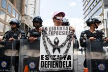 An undated photograph showing a demonstrator holding a sign supporting freedom of the press during a protest in Caracas, Venezuela. EFE FILE