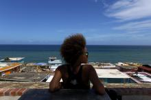 A resident looks at the damages caused by Hurricane Maria, at the neighborhood La Perla of San Juan, Puerto Rico, Sept. 29, 2017.