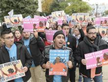 Deferred Action for Childhood Arrivals (DACA) recipients hold a march in Washingon on Nov. 9 to demand that Congress pass legislation to regularize their immigration status.