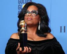 A handout photo made available by the Hollywood Foreign Press Association (HFPA) on Jan. 08, 2018 shows Oprah Winfrey (L) accepting the Cecil B. DeMille Award for her 'outstanding contribution to the entertainment field' as Reese Witherspoon (R) looks on during the 75th annual Golden Globe Awards ceremony at the Beverly Hilton Hotel in Beverly Hills, California, USA, Jan. 07, 2018.