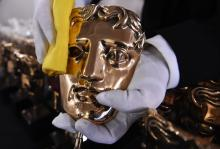 A BAFTA mask award is being polished before the 2017 EE British Academy Film Awards take place at the Royal Albert Hall in London, Britain, Feb. 12, 2017.