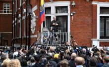 Australian activist Julian Assange speaks to the media from the balcony of the Ecuadorian Embassy in London, Britain, May 19, 2017.