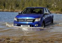 An undated handout photo released by Ford Motor Company on Mar. 23, 2011 shows a new Ford Ranger pickup truck drives through a stream at an undisclosed location.