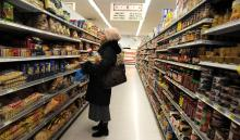 A woman shops at a supermarket in Brooklyn.