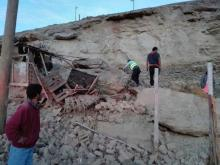Photo provided by the Agencia Andina news agency showing the rescue of one of the victims of the powerful earthquake that struck southern Peru on Jan. 14, 2018.