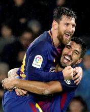 FC Barcelona's Argentinian forward Leo Messi (R) celebrates with Uruguayan forward Luis Suarez after scoring the 2-4 lead against Real Sociedad during the Primera Division Liga match held between Real Sociedad and FC Barcelona at Anoeta stadium in San Sebastian, Basque Country, Spain, 14 January 2018.