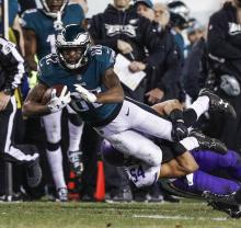 Philadelphia Eagles wide receiver Torrey Smith (L) is tackled by Minnesota Vikings middle linebacker Eric Kendricks (R) in the first half of the NFC Championship game between the Minnesota Vikings and the Philadelphia Eagles at Lincoln Financial Field in Philadelphia, Pennsylvania, USA, 21 January 2018. EPA-EFE