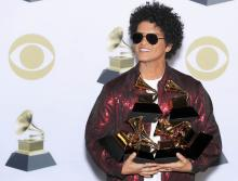 Bruno Mars poses with his six Grammys in the pressroom during the 60th annual Grammy Awards ceremony at Madison Square Garden in New York, New York, USA, 28 January 2018.