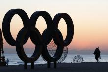 A South Korean soldier patrols next the Olympic rings installation at Gyeongpo beach, near the venues of Gangneung Ice Arena, Oval and Hockey Centre of the PyeongChang Winter Olympic Games 2018, in Gangneung, South Korea, 30 January 2018.