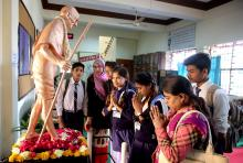 Indian school children pay their respects at a Gandhi statue at Gandhi Bhavan, on the 70th anniversary of the death of father of the nation Mahatma Gandhi, on Martyrs' Day in Bhopal, India, Jan. 30, 2018.