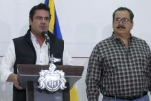 Jalisco Gov. Aristoteles Sandoval (L) and Jalisco Attorney General Raul Sanchez at a press conference in Guadalajara, Jalisco, Mexico, March 25, 2018. EPA-EFE/CARLOS ZEPEDA