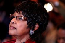 File image of Winnie Madikizela-Mandela listening to a speech at the opening of the Mandela House museum in Soweto, South Africa, Mar. 19, 2009. EPA-EFE FILE/JON HRUSA