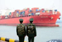Border guards work at a container port in Qingdao, Shandong province, China, Mar. 08, 2018. EPA-EFE/FILE/YU FANGPING CHINA OUT