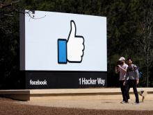 People walk past Facebook's 'Like' icon signage in front of their campus building in Menlo Park, California, Mar. 30, 2018. EPA-EFE/FILE/JOHN G. MABANGLO