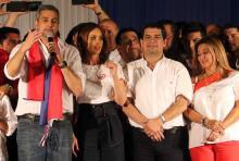 Candidate of the ruling Colorado Party Mario Abdo Benitez (L) speaks, accompanied by his wife Silvana Lopez (2-L), his candidate to the vice presidency Hugo Velazquez (2-R) and Lourdes Samaniego (R), wife of Velazquez, in front of the headquarters of the Colorado Party in Asuncion, Paraguay, Apr. 22, 2018. EPA-EFE/ANDRES CRISTALDO