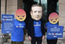 A protester wearing a mask depicting Facebook's CEO, Mark Zuckerberg, flanked by two protesters wearing angry emoji masks protest outside Portcullis House in central London, Britain, Apr 26, 2018. after allegations that information on millions of its users was misused. EPA-EFE (FILE) /FACUNDO ARRIZABALAGA