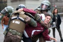 A young man is arrested by the police during a protest against gender violence in Santiago, Chile, May 16, 2018. EPA-EFE/MARIO RUIZ