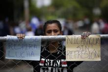A group of people protest in front of the Fatima Seminar where the National Talks started earlier today in Managua, Nicaragua, 16 May 2018. The talks seek to solve the socio-political crisis in the country with the participation of President Ortega, who was confronted by protesters. EPA-EFE/Bienvenido Velasco