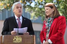 Chilean president Sebastian Piñera (L) and the head National System for Minors (Sename) Susana Tonda (R) speak during a visit to the Galvarino shelter, in Santiago, Chile, May 24, 2018. EPA-EFE/Mario Ruiz