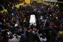People accompany the coffin of the Guatemalan migrant Claudia Patricia Gomez Gonzalez during her wake, in San Juan Ostuncalco, Quetzaltenango, Guatemala, May 31, 2018. EPA-EFE/ESTEBAN BIBA