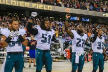 Philadelphia Eagles defensive player Steven Means (2-L), Philadelphia Eagles defensive player Malcolm Jenkins (3-L) and Philadelphia Eagles defensive player Ron Brooks (4-L) stand with their fists in the air during the singing of the US National Anthem before the start of the NFL American Football game between the Philadelphia Eagles and the Chicago Bears at Soldier Field in Chicago, Illinois, USA, 19 September 2016. EPA-EFE/FILE/TANNEN MAURY
