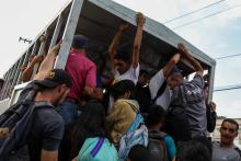 People climb onto the back of a truck in Caracas, Venezuela, 08 June 2018 (issued 10 June 2018). Citizens are using other means of transportation as the political and socioeconomic crisis in the country has left the transportation system on the verge of collapse. EFE-EPA/CRISTIAN HERNANDEZ