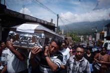 People attend the burial of Aura Yolanda Perez Paz, 17, who died in San Miguel Los Lotes during the volcanic eruption, in the municipality of Alotenango, Department of Sacatepequez, Guatemala, 12 June 2018. EFE