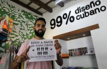 "Havana's Al Pirata coffee shop on Aug. 13, 2018, displays a poster that translates as ""I'm in favor of Cuban design: a very original family"" - and allusion to the new constitution that will open the way to gay marriage on the island. EFE-EPA/Yander Zamora"