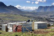 File photo showing South African men building an illegally erected shack during a land invasion on the property of Louiesenhof Wine farm in the heart of the major wine producing region of Stellenbosch, South Africa, Aug. 8, 2018. EPA-EFE/Nic Bothma