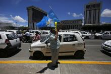 Photograph showing cab drivers protesting Uber in Guatemala City, Guatemala, Aug. 27, 2018. EPA-EFE/Esteban Biba