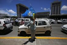 Photograph showing cab driversprotesting Uber in Guatemala City, Guatemala, Aug. 27, 2018. EPA-EFE/Esteban Biba