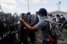 "Protesters face off with riot police during a march called ""Rescue the Homeland"" in protest against President Daniel Ortega in Managua, Nicaragua, on September 16, 2018. EPA-EFE/Esteban Biba"