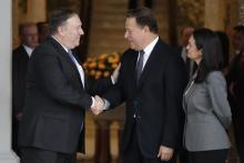 U.S. Secretary of State Mike Pompeo (L) and Panamanian President Juan Carlos Varela (R) shake hands next to Panamanian Vice President and Foreign Minister Isabel de Saint Malo, at Las Garzas Presidential Palace, in Panama City, Panama, October 18, 2018. EPA-EFE/Bienvenido Velasco