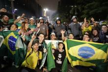 Supporters of ultrarightist Brazilian presidential candidate Jair Bolsonaro, who handily won the run-off election on Oct. 28, 2018, take photos as they celebrate his victory in Sao Paulo. EFE-EPA/Sebastião Moreira