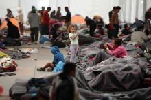 Migrants rest in a shelter set up at a soccer stadium in Mexico City on Nov. 6, 2018, the day Mexico's National Human Rights Commission (CNDH) reports that roughly 80 people who entered the country with the caravan of Central American migrants bound for the United States have gone missing.  EFE-EPA/Jose Mendez