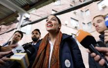 Alexandria Ocasio-Cortez (C), who is running as the Democratic nominee for New York's 14th congressional district, talks with reporters after casting her ballot in the 2018 midterm general election at a polling site in the Bronx, New York, USA, Nov. 6, 2018. EPA-EFE/JUSTIN LANE