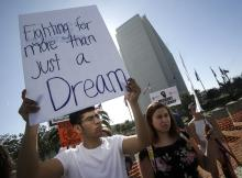 A protester holds a sign that reads 'Fighting for more than just a Dream' as he joined Dreamers and hundreds of demonstrators calling for DACA (Deferred Action for Childhood Arrivals) protection and protesting against US President Donald Trump in a national day of action outside the Federal Building in Los Angeles, California, USA, 03 February 2018. (Protestas, Estados Unidos) EFE/EPA/FILEMIKE NELSON
