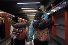 Members of the caravan of Central American migrants prepare to depart Mexico City, Mexico, on their way to the United States, Nov. 9, 2018. EPA-EFE/Sashenka Gutierrez